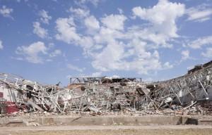 Flattenned high school building after tornado